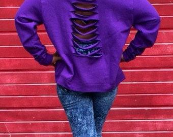 Purple ripped sweatshirt