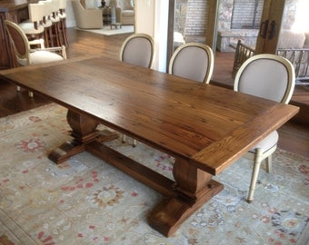 Trestle dining table in reclaimed chestnut.