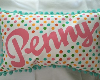 Pillow with bright polka dots and personalized name.