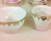 Pink Banded Creamer and Sugar Bowl with Gold Tassels