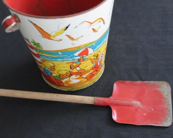 vintage metal sandpail and shovel