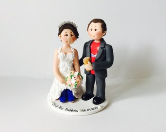 Personalised gardening and sports theme wedding cake topper - Groom in jersey with a pint beer and bride in wellies wedding cake topper