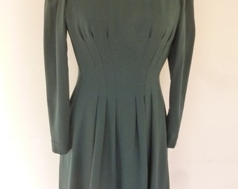 Pauline Trigere Dress Vintage 70's Teal Blue Wool Crepe Day Dress Cinched Waist Full Skirt Size 6 Sold at Halle's Specialty Shop