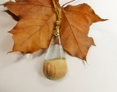 Medium to large teardrop wood resin fusion pendant. Clear amber resin and maple wood pendant. All natural UVpoxy.
