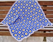 Nice floral pattern blanket with white border for babies.