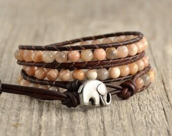 Bohemian chic beaded leather wrap. Triple wrap pink sunstone bracelet. Elephant button charm