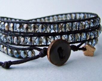 Handmade wrap bracelet with light sapphire blue fire polished faceted czech glass beads