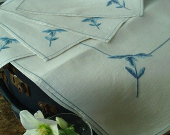 Set of Vintage tea-cloth and 4 napkins. Off- white linen with pale blue embroidery