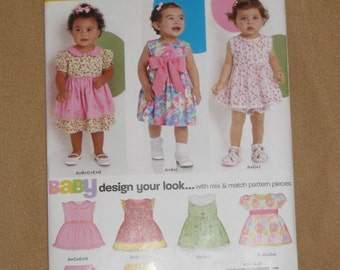Uncut Pattern - New Look 6877 - Infant dress and bloomers - 4 sizes - NB, S, M, L