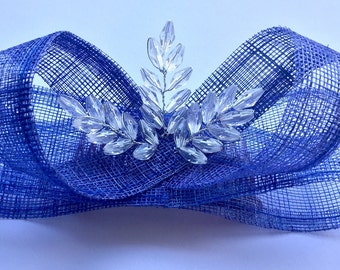 Kate Middleton inspired blue sinamay fascinator with crystal detail at centre