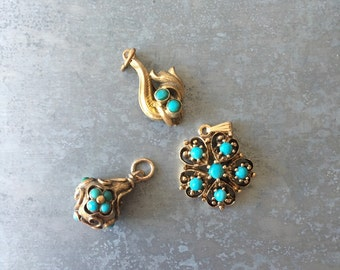 Antique Turquoise and 14 kt / 12kt and 9 kt Gold flower motif pendents or charms.