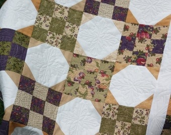 Snowball Quilt in Audra's Iris Garden fabrics by Brannock and Patek - custom quilted measuring 38 inches by 50 inches
