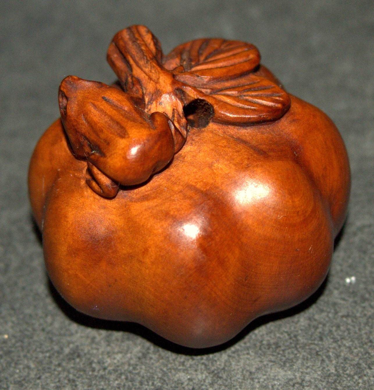 Netsuke hand carved wood figurine frog on a pumpkin signed