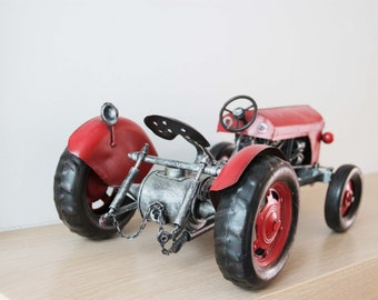 Red tractor miniature, vintage, collectible red tractor, detailed old fashioned tractor of tin and rubber and plastic, early nineties