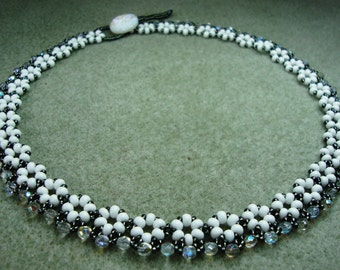 Beadwoven necklace with white and crystal glass beads and button