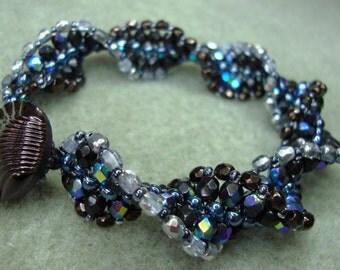 Spiral beadwoven bracelet from Czech firepolished beads and Czech glass button