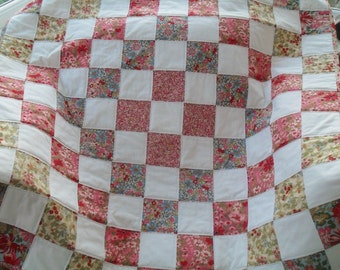floral and white handmade patchwork cot quilt, baby blanket, lap quilt