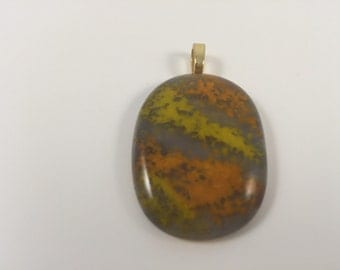 Yellow and orange accents on tan fused glass pendant