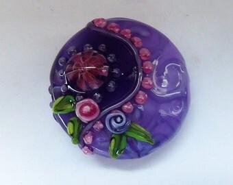 Glass lampwork bead.
