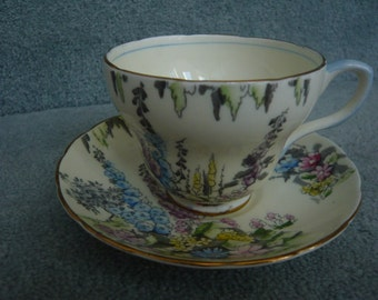 EB Foley Teacup and Saucer Hand Painted Cream Colour Garden Flowers Blue Handle & Gold Trim