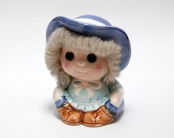 Vintage ceramic girl money-box with wool hair detail