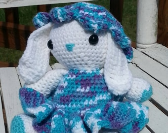 White bunny in blue variegated outfit