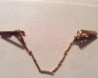 very nice vintage gold tone sweater guard in great condition nice link chain 8 1/4'' long