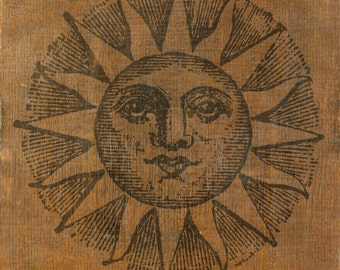 Vintage print of the sun. B/W print on wood.