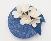 1940s-1950s aloha pin up inspired round fascinator hat with Hawaiian cream felt flowers and a blue straw base