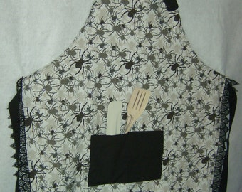 Spiders apron with black lace and trim with utensils