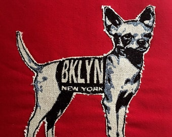 Brooklyn Dog  embroidery on wool felt on red or blue pillow.
