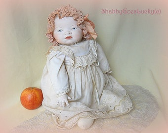 Bye Lo baby doll, large German made bisque head baby with 'frog' cloth body, 1979 replica from Grace S. Putnam classical old character baby