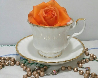 Vintage tea cup and saucer by Richmond (bought by Royal Albert) white with thick gold gilding. TS087