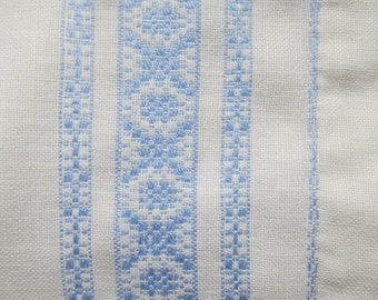 Blue Swedish huck weaving doily; pale blue huck embroidery on white
