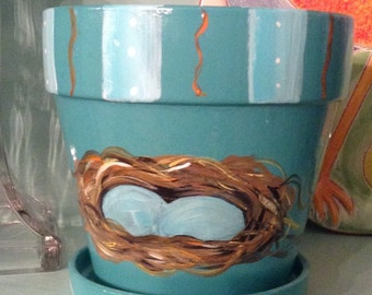 Turquoise Flowerpot with Robins Eggs in Nest Pattern