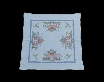 A vintage cross-stitch embroidered linen tablecloth, depicting Asian pagodas, c.1940s