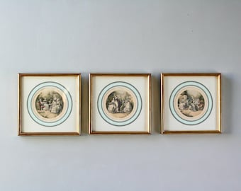 three antique french colored gravures in wooden medalion frame