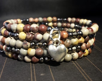 A 4mm Crazy Horse Stone Bead Memory Wire Bracelet.