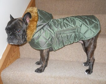 The Barka dog coat! Waterproof quilted dog coat with polar fleece lining and fur trimmed hood.