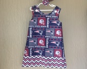 New England Patriots Dress w Chevron Band, Blue and Red, NFL Football (infant, baby, girl, toddler,child) with matching hair accessory.
