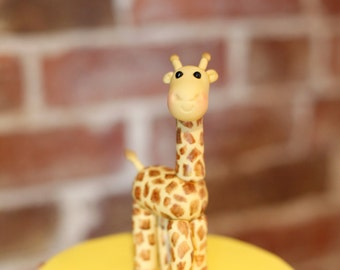 Sugar giraffe for decorating birthday cake, made from edible materials.  Can be made in any colour.
