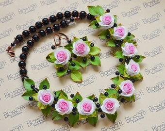 White Pink roses and little black berries
