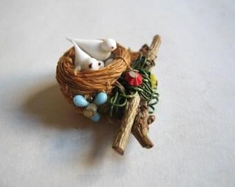 20's bird nest brooch