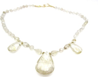 rutilated quartz with briolettes