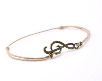 Bracelet music bronze beige cord