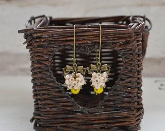Yellow white rondelle dangle earrings