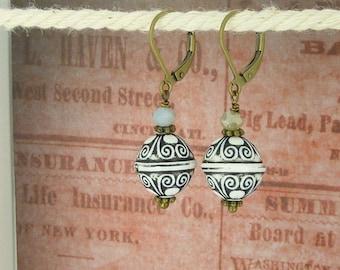 bronze earrings ornament black white