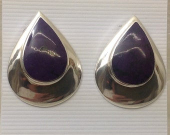 Large post earrings featuring purple sodalite cabs.
