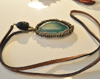Beautiful necklace, made of natural leather cord, lava, and agate stone. Handmaded from brass wire.