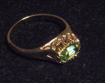 Gorgeous Gold Ring with Green Stone